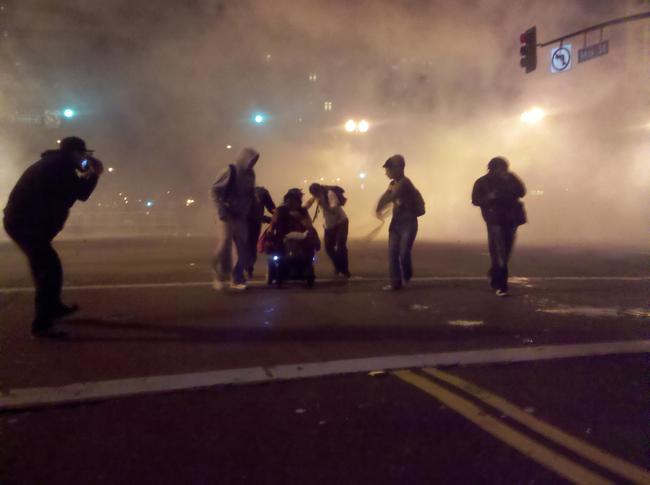 Protestors help wheelchair user