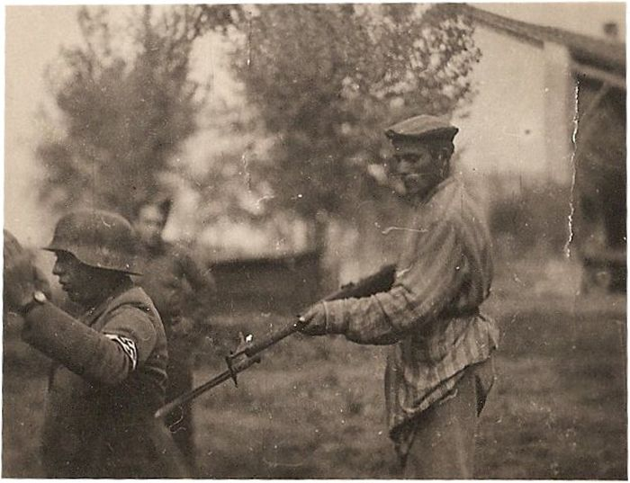 Liberated prisoner holds Nazi at gunpoint