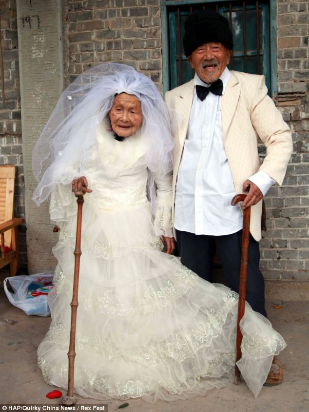 Elderly couple in wedding outfits