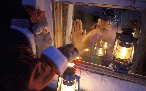 Santa claus waving to man in sauna