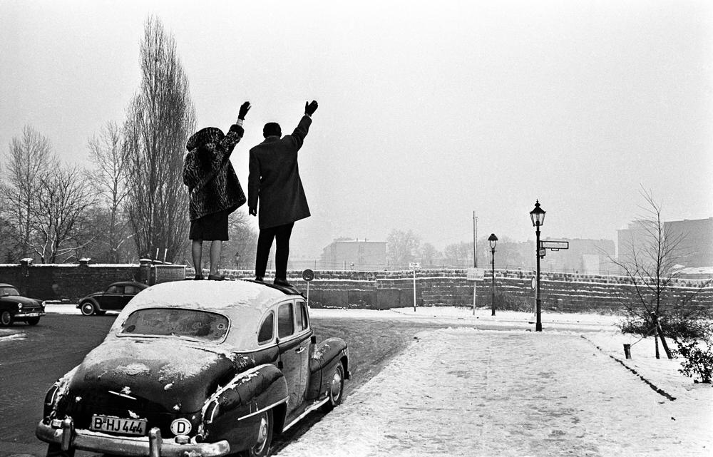 west berlin couple wave to family in east berlin