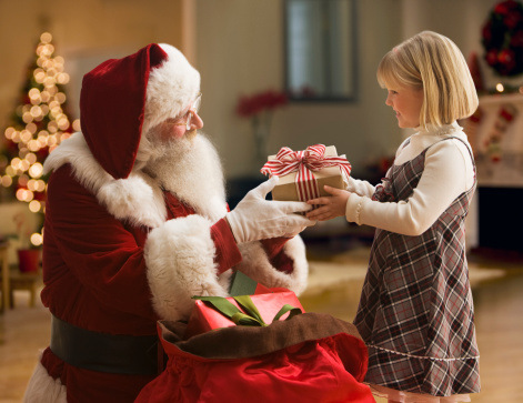 Santa Claus giving a present to a little girl