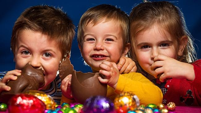 children eating chocolate easter eggs