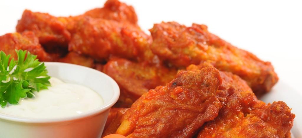 Spicy hot buffalo chicken wings shot closeup.