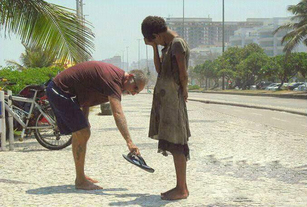 Man offers shoes to homeless girl