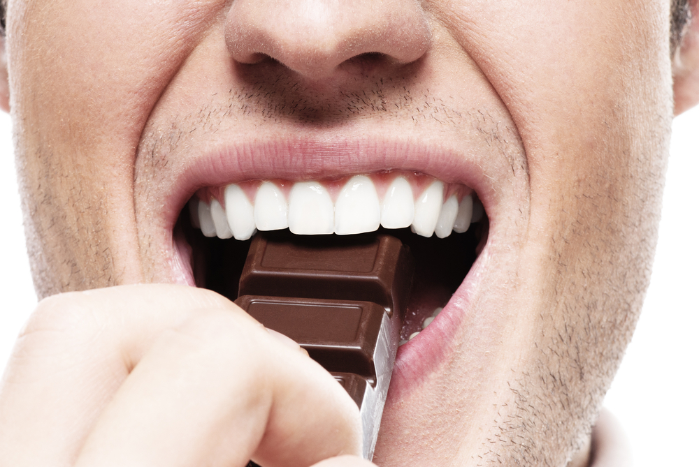 man eating chocolate