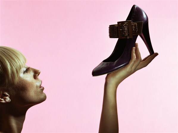 woman looking at shoe